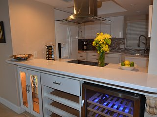 Updated kitchen with high end appliances and wine cooler.
