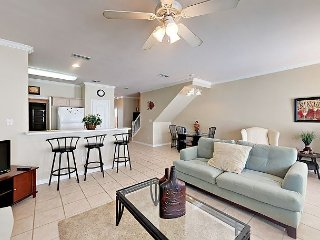 Modern 3BR Condo w/ 2 Living Areas, Garage & Pool – Short Walk to Beach