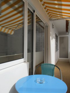 outside balcony table and chairs and canopie