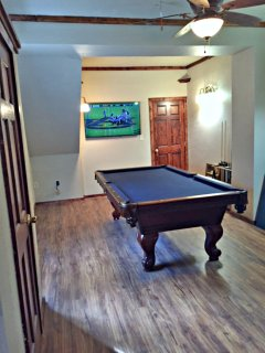 Pool table room with 55' flat screen smart tv