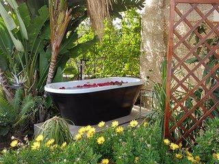 Outdoor bath tub.