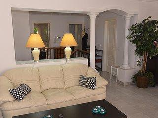 2 white italian leather sofas
