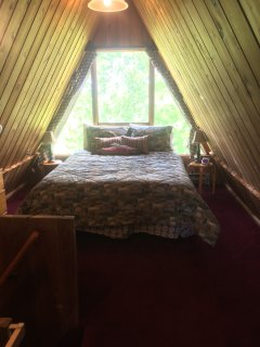 Cheerful loft bedroom 10 feet by 25 feet.  Queen bed, double futon, small TV with DVD/VCR, balcony.
