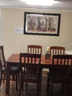 The dining room with a Waltzing Matilda triptych commissioned by the Winton Shire Council.
