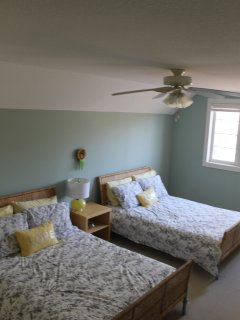 Upstairs Bedroom with two Double Beds and View of Grand Bend Harbour