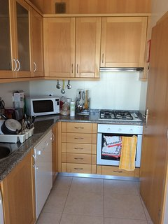 Kitchen with patio door access to long balcony