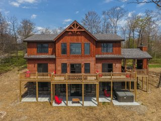 New for 2017! Escape from Reality sits on over an acre of property and is a newly constructed, custom-built log home offering top amenities and a modern interior!