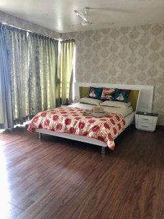 Huge master bedroom with warm and classic tones. Had an ensuite.