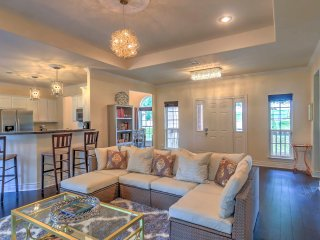 Relax in the home's elegant, tastefully-decorated living room.