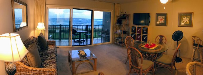 Beautiful and spacious living room overlooks the ocean/beach 50 yards away.