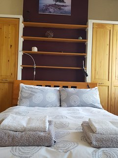 Quality bed linen, plenty of wardrobe space, and under-bed storage for cases