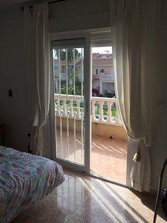 Master bedroom balcony overlooking pool