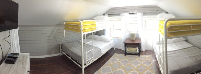 AWESOME, spacious bunk room (upstairs) with tv.  2 Single over Double bunks