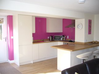 Open plan fully fitted kitchen.