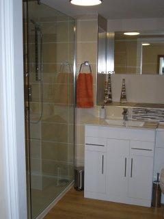 Partially tiled spacious bathroom.