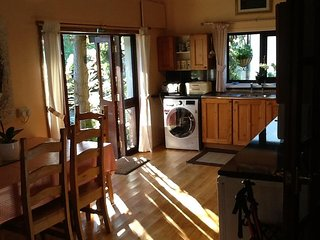 Open plan kitchen. Access to front and rear gardens.