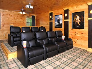 Professional theater room with fully reclining seats with iphone charging ports.