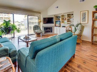 Canalside dog-friendly home w/ dock, spacious deck, gas grill, & golf cart!