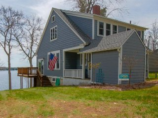 Charming lakefront home w/ private dock, wood fireplace & modern conveniences
