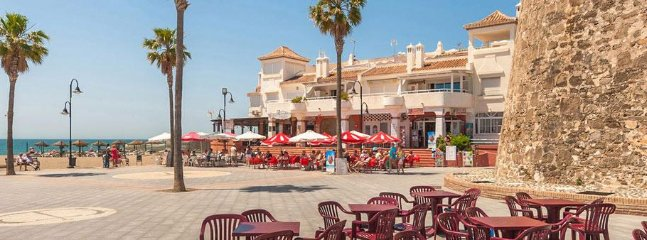 Watch tower in centre of La Cala, by the beach, evening seasonal market stalls here too.