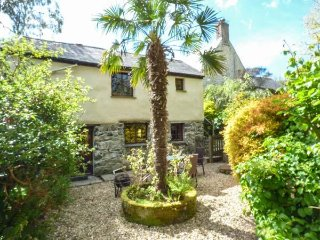 PRIORY COTTAGE, tranquil, logburner, fishpond, seaside, sleeps four, near St