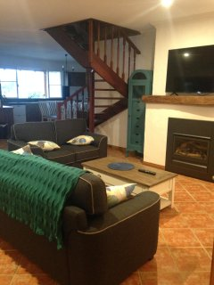 Family area with Electric Fireplace and Large screen Smart TV.