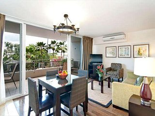 Contemporary Designer End Unit Condo by the Beach with Two Large Lanais