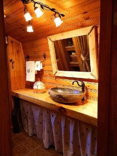 The luxury en-suite bathroom features a tile tub and shower.