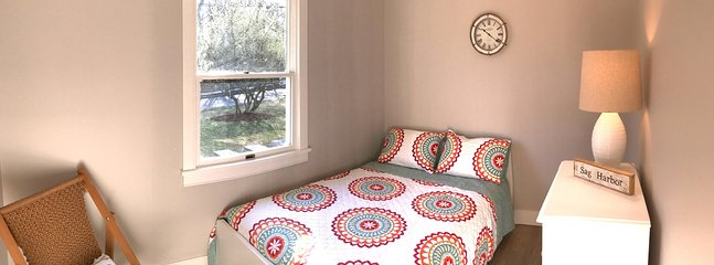 Guest bedroom, with view of the dogwood tree.
