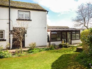 WHITEHALL COTTAGE, upside down accommodation with views over garden, WiFi