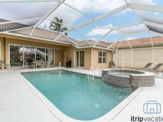 Well appointed Briarwood single story home w/pool, spa & tranquil lake