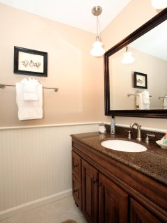 Renovated Master Bath with quartz top vanity. Bath linens are provided with every rental.