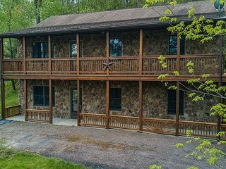 2 covered decks & a central location with seasonal lake views!