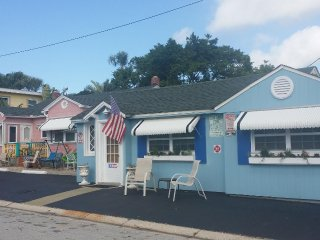 Pink Gulfside cottage to left, Blue Corner Cottage to right if full