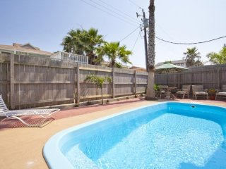 home with a pool, balconies, a bar & a pool table - walk to beach!
