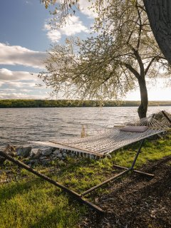 Relax lakeside in one of the hammocks under flowering trees during the spring bloom. ©2016
