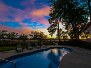 Soak in the gorgeous sights & sounds of the Ashley River from this 5 bedroom