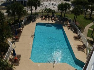 Only 100 yards to the beach and right next door to the pool!