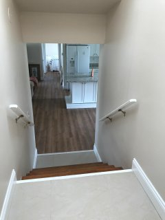 5 stairs leading to 2 upstairs bedrooms and laundry room