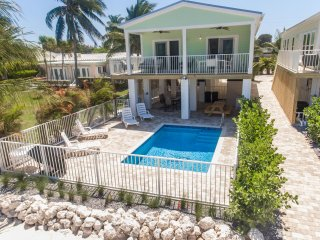 Brand New Direct Gulf Front Home Sleeps 10 Boat Dock, Beach, and Private Pool