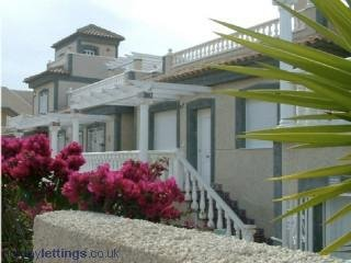 Villamartin holiday villa rental with shared pool, beach nearby, balcony&terrace