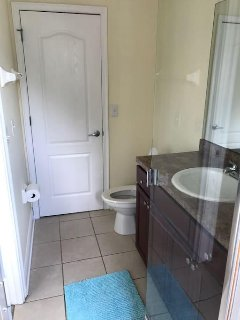 The second bedroom's bathroom. Walk in closet behind the door. Shower no tub.