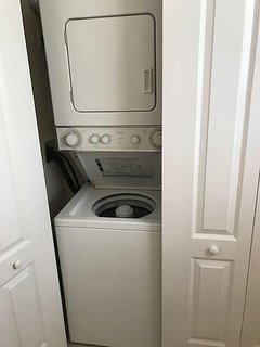 Stackable washer and dryer. Does small loads but gets the job done.