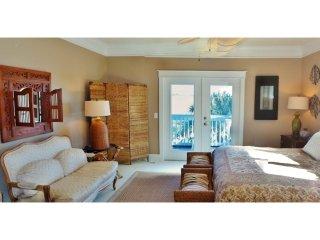 Master suite. Has doors that open to deck facing marsh