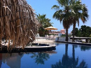 One bedroom and loft, with pool facing balcony, 2 min from beach