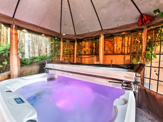 Soothe your muscles in the large hot tub in the backyard.