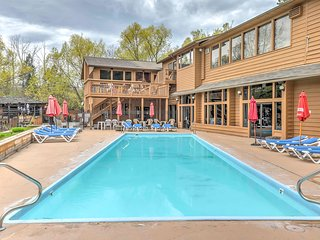 Spend your afternoon lounging poolside at this Bigfork vacation rental condo.