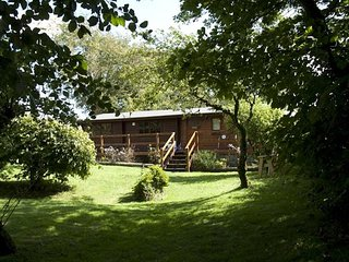 THE LOG CABIN, detached with views of fields and countryside, on-site swimming