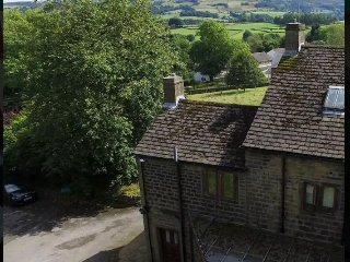 Aerial view of the cottage from the back