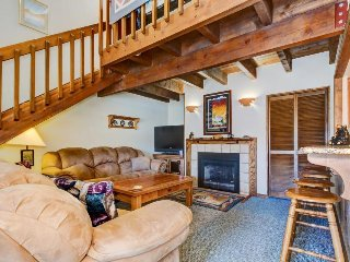 Lofty condo w/ deck and shared pool, sauna & gym - walk or shuttle to the lifts!